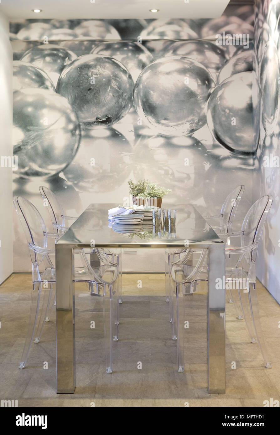 Philippe Starck Louis Ghost Chairs At Metal Table In Modern Dining Room