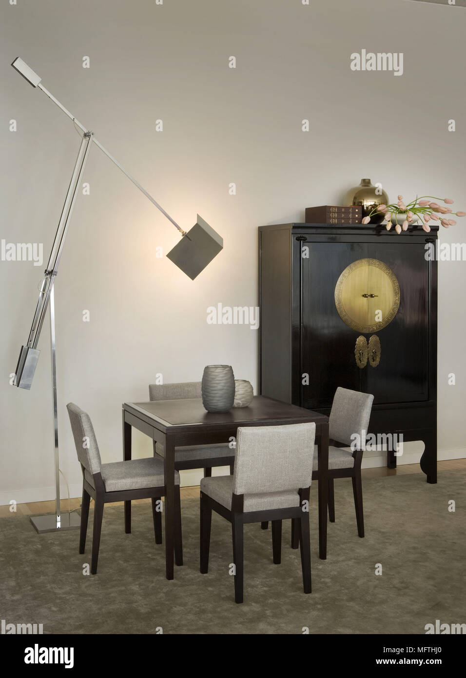 Wooden Table And Upholstered Chairs Next To Chinese Cabinet In Modern Dining Room