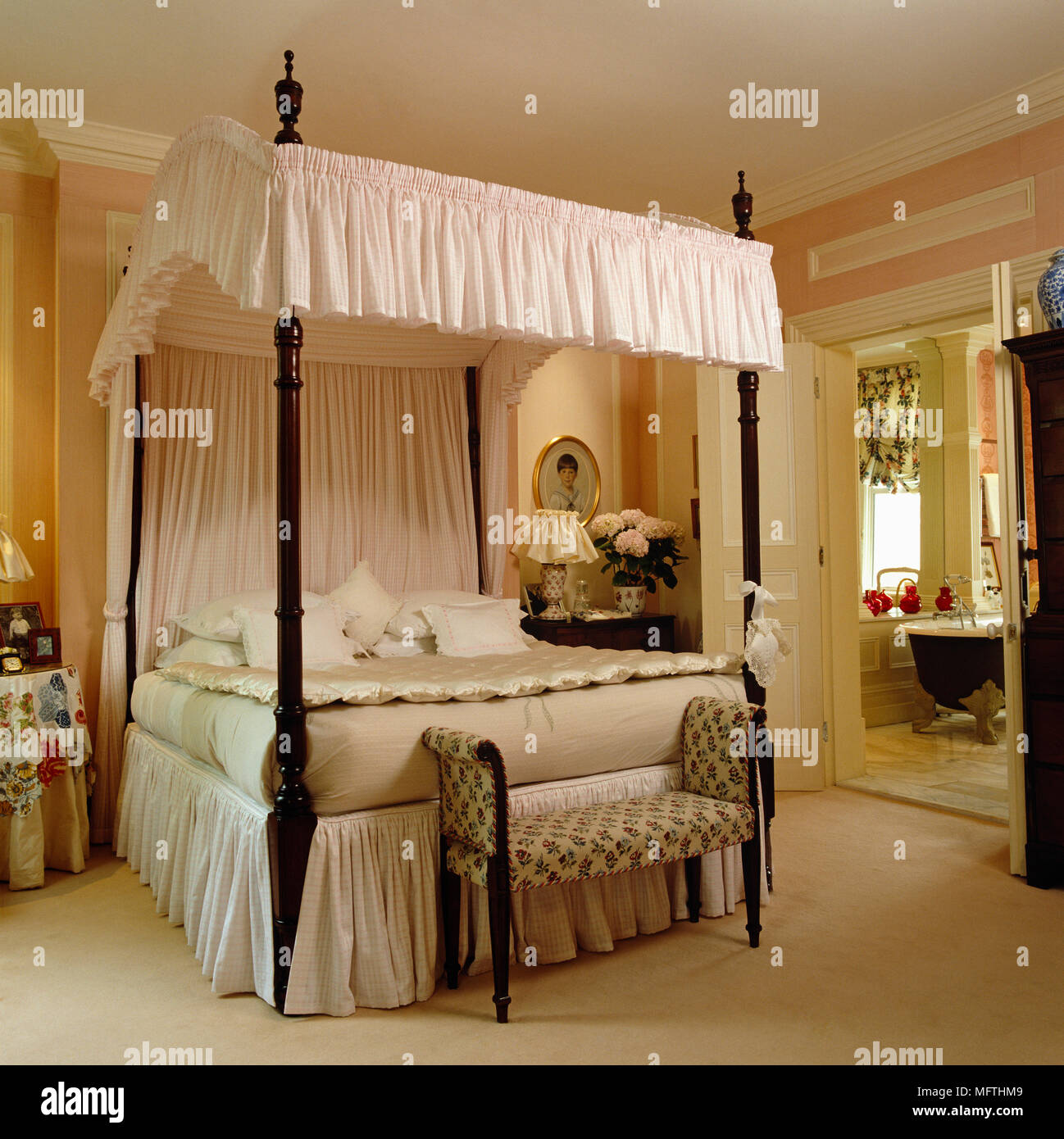 Beautiful Opulent Four Poster Bed With White Canopy Above Bed In Pink Bedroom   Stock  Image