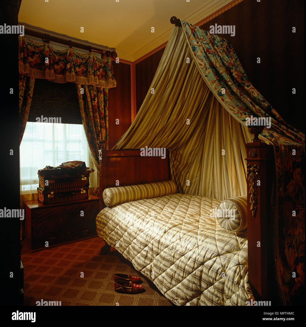 Fabric Canopy Above Single Bed With Dark Polished Wooden Bed Frame