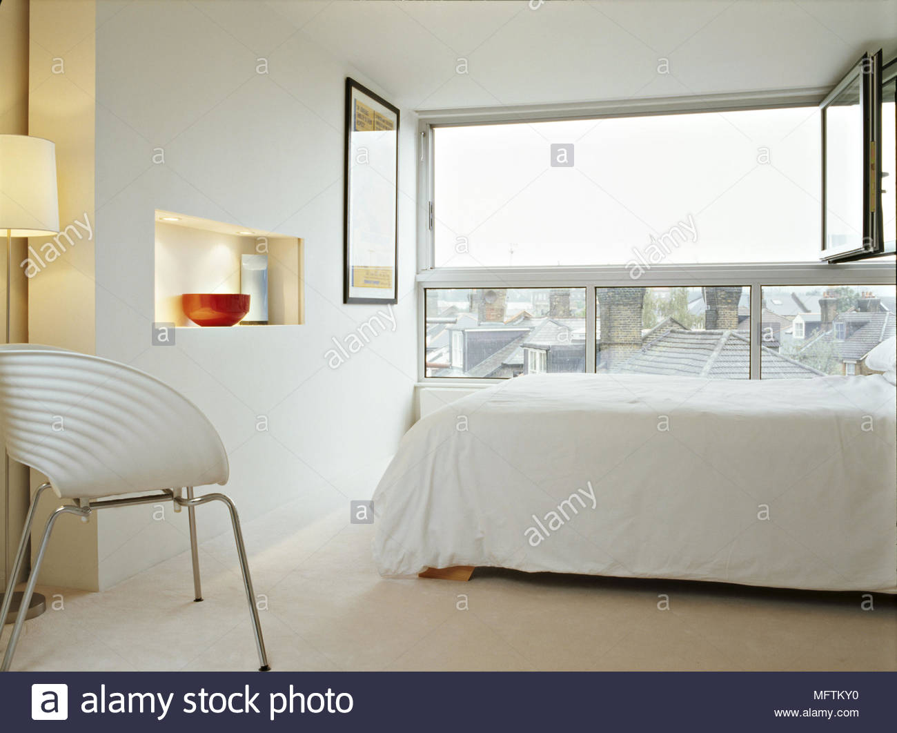 A Detail Of Modern White Bedroom Retro Chair Open Window Bed Linen