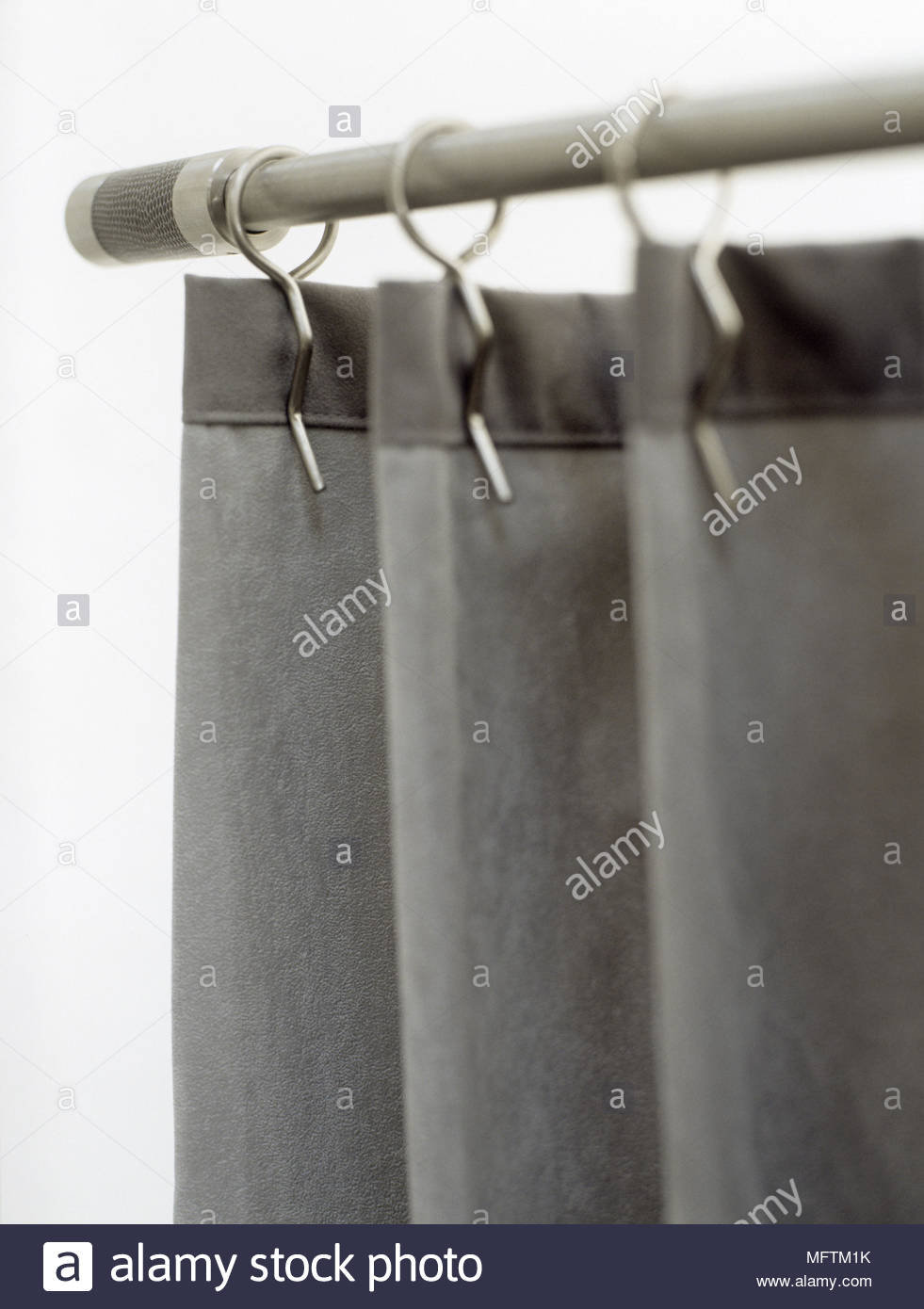 A Detail Of Gray Soft Suede Curtains Hung From A Metal Curtain Rod Fixed  Metal Rings