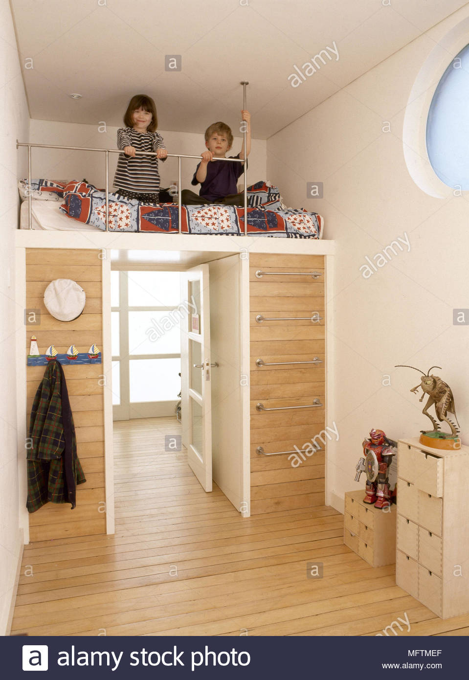 Child? bedroom raised bed unit steel ladder wood floor children on ...