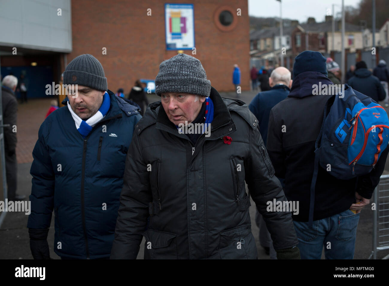 Two fans walking round the ground before Blackburn Rovers played Shrewsbury Town in a Sky Bet League One fixture at Ewood Park. Both team were in the top three in the division at the start of the game. Blackburn won the match by 3 goals to 1, watched by a crowd of 13,579. - Stock Image