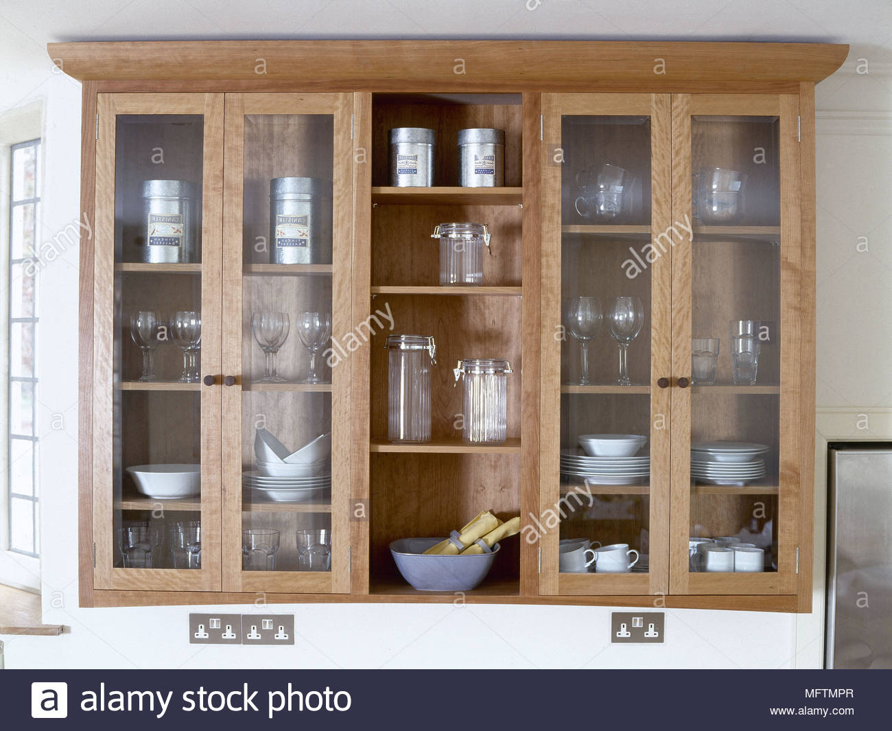 Detail Of A Wooden Display Cabinet With Glass Doors.