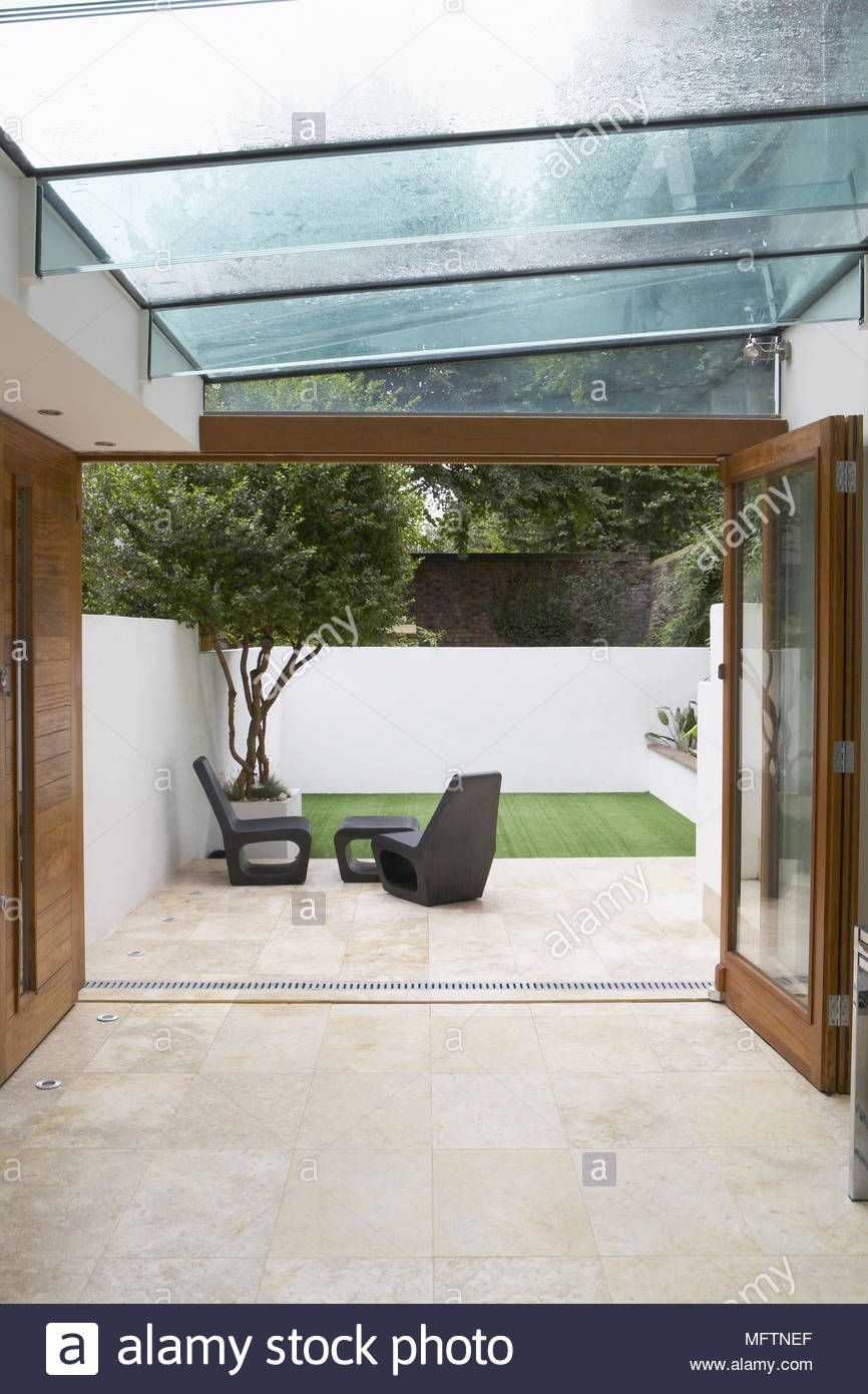 Hallway With Glass Roof And Open French Doors To Modern Courtyard