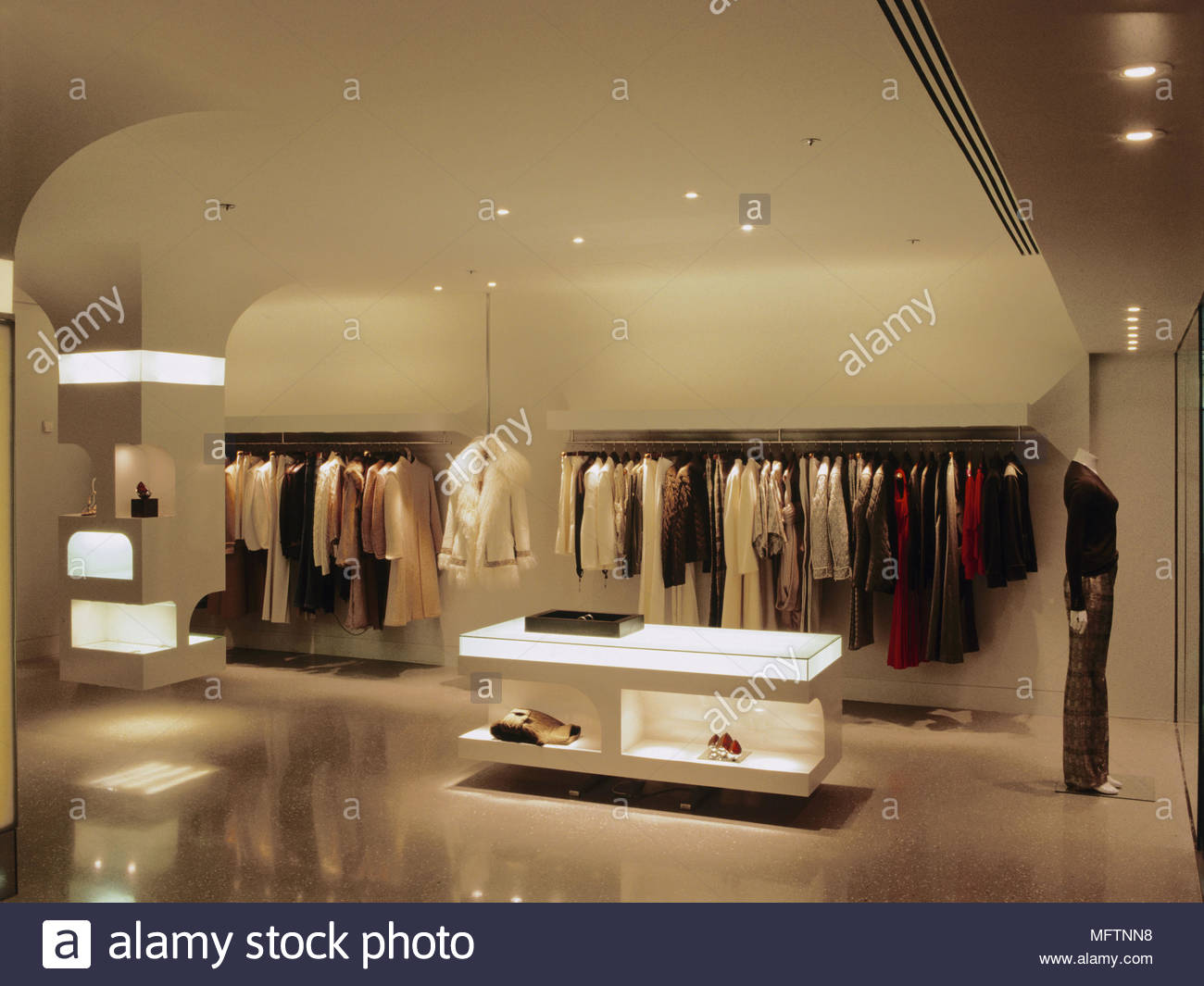 Interior of clothing shop  Interiors designer shops shopping retailing display clothing - Stock Image