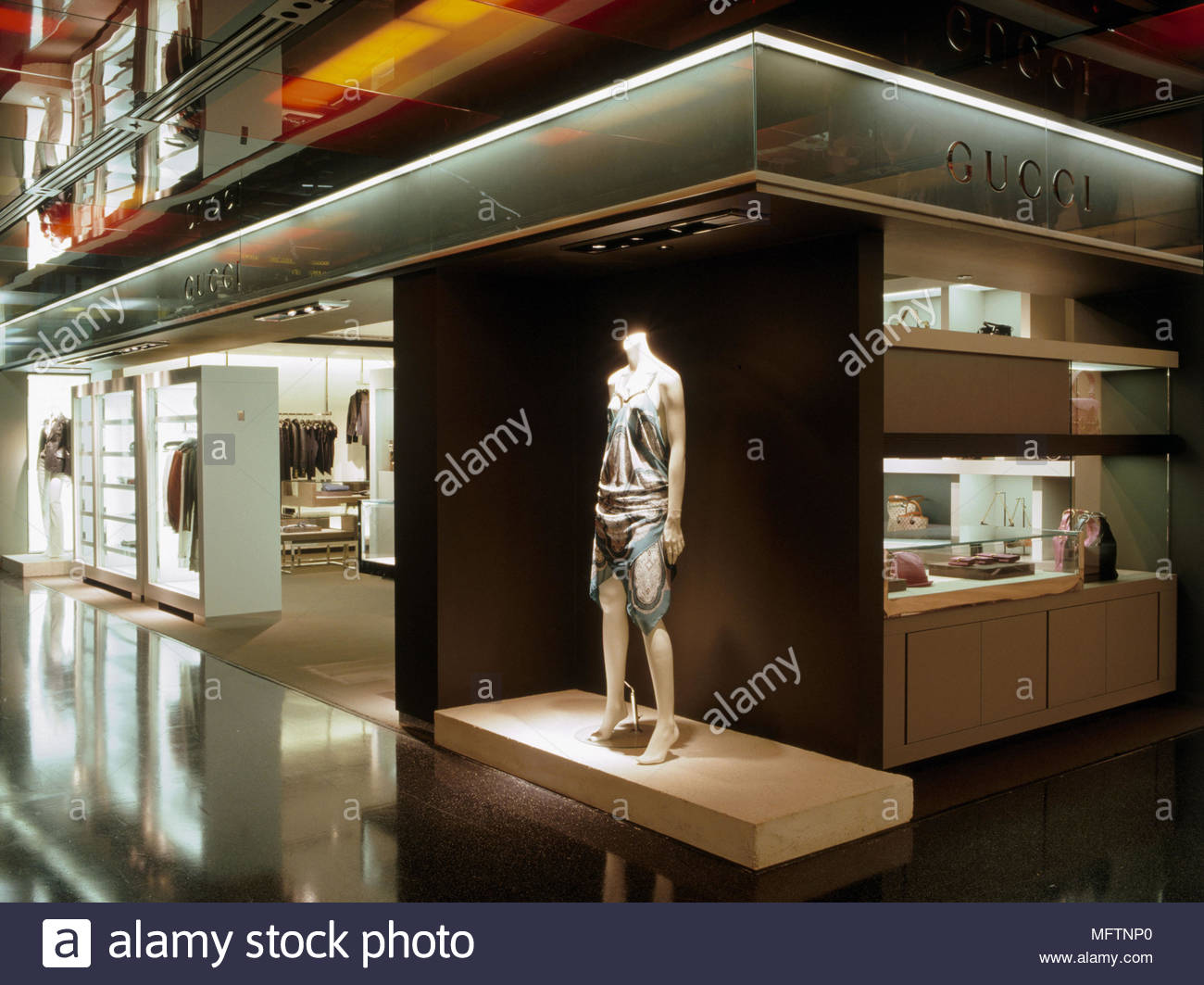 495f417c846 Interior of Gucci shop within shopping complex Interiors designer shops  shopping retailing display clothing mannequins