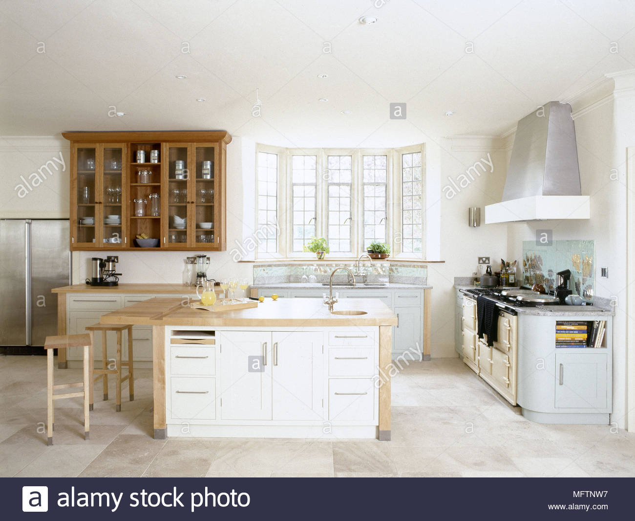 Kitchen with a central island breakfast bar sunny bay window and ...