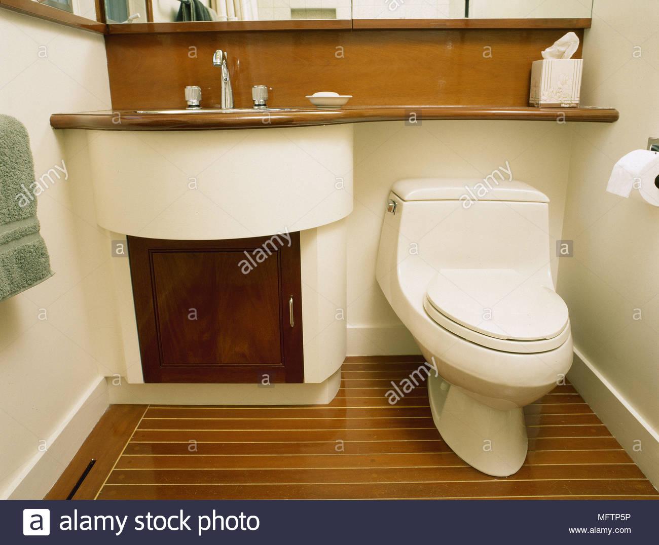 Modern Bathroom Detail Washbasin Set In Cupboard Unit Toilet Wood Floor