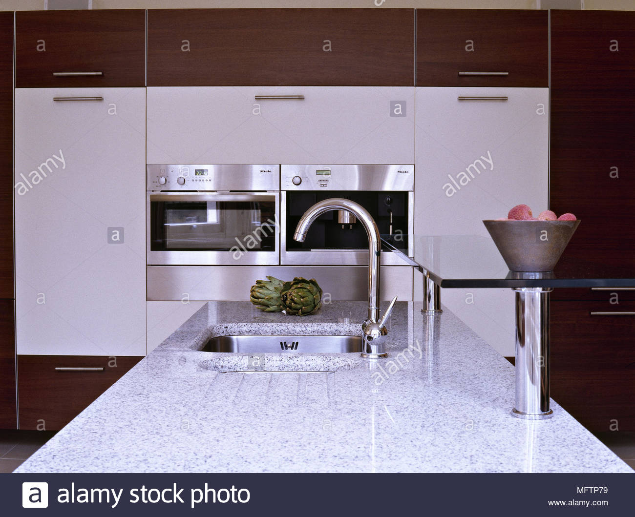 Modern kitchen white units stainless steel oven granite work top ...