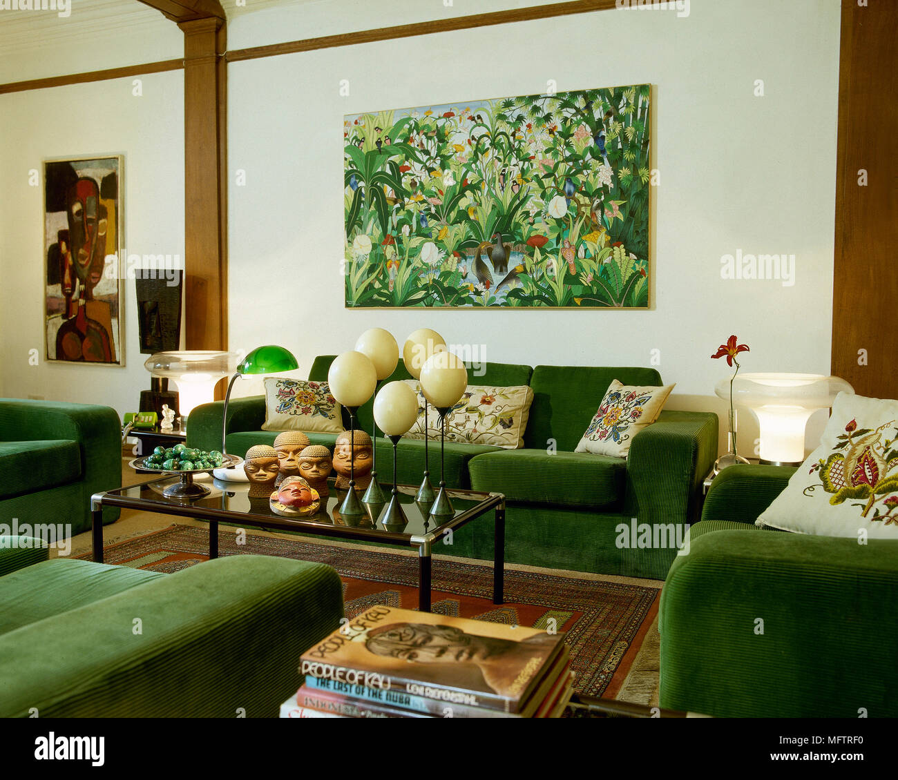 Sitting Room With Green Sofas And Glass Coffee Table Stock Photo