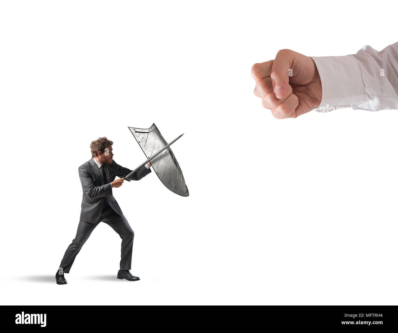 Little business man challenges big problems fighting with shield and sword - Stock Image