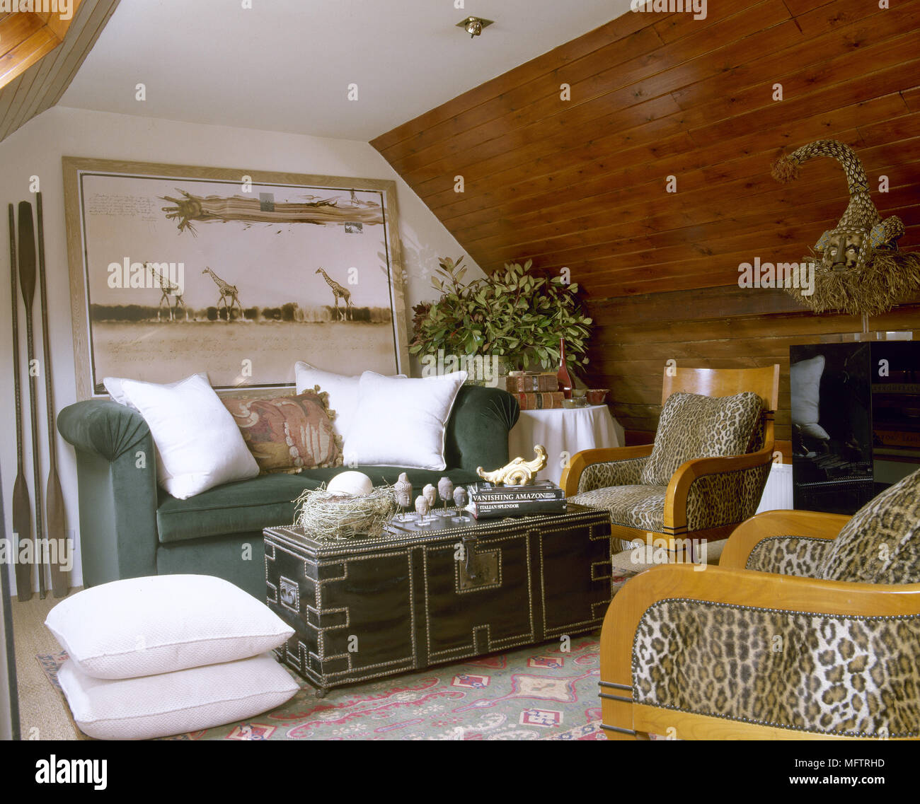 Exotic Sitting Room With A Sloping, Wood Panelled Ceiling, Sofa, Coffee  Table, And Animal Print Chairs.