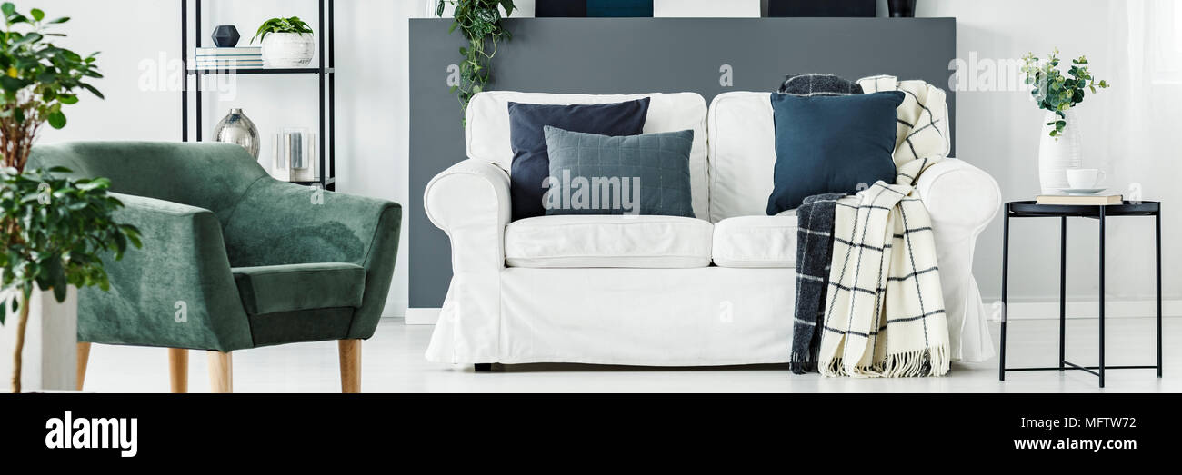 White Sofa With Dark Pillows And Patterned Blankets Standing In Fascinating Patterned Blankets