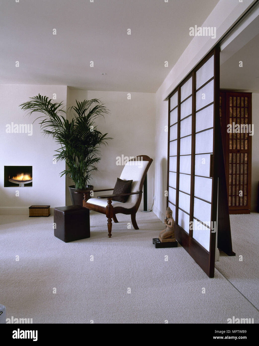 A Modern White Sitting Room Neutral Carpet Simple Fireplace ...