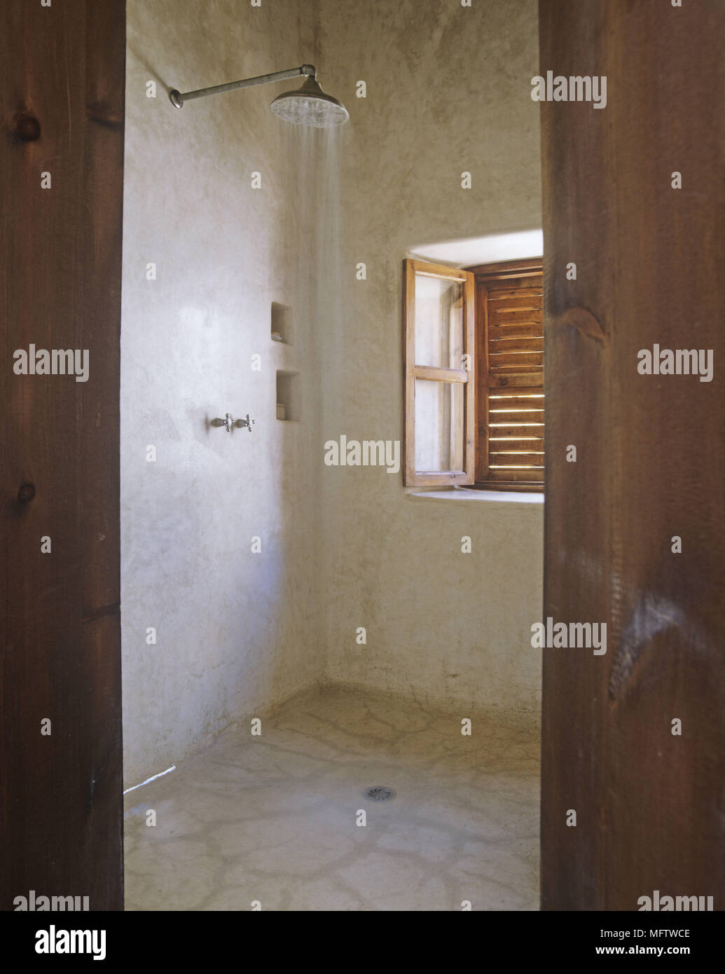 Groovy A Rustic Stone Shower Wet Room Window Shutters Stock Photo Download Free Architecture Designs Scobabritishbridgeorg