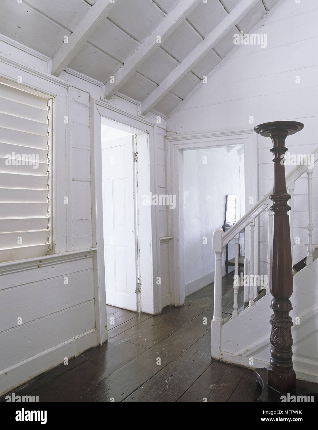 An Overview Of A Traditional Country Style Hallway With Dark