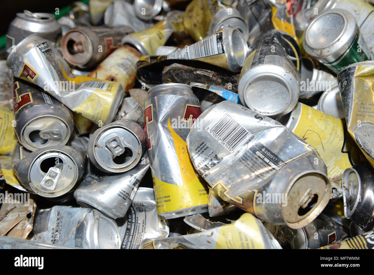Bins full of wasted discarded aluminium tins cans from the road side - Stock Image