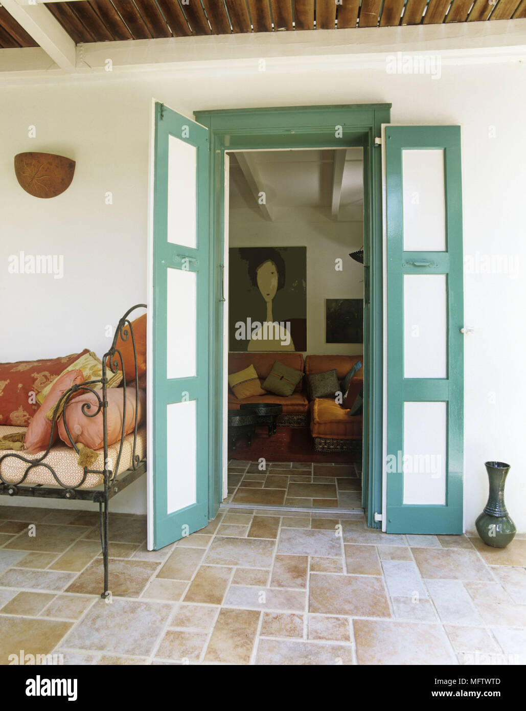 Details Of The Traditional Front Porch With Stone Floor View Through The Front  Door With Shutters.