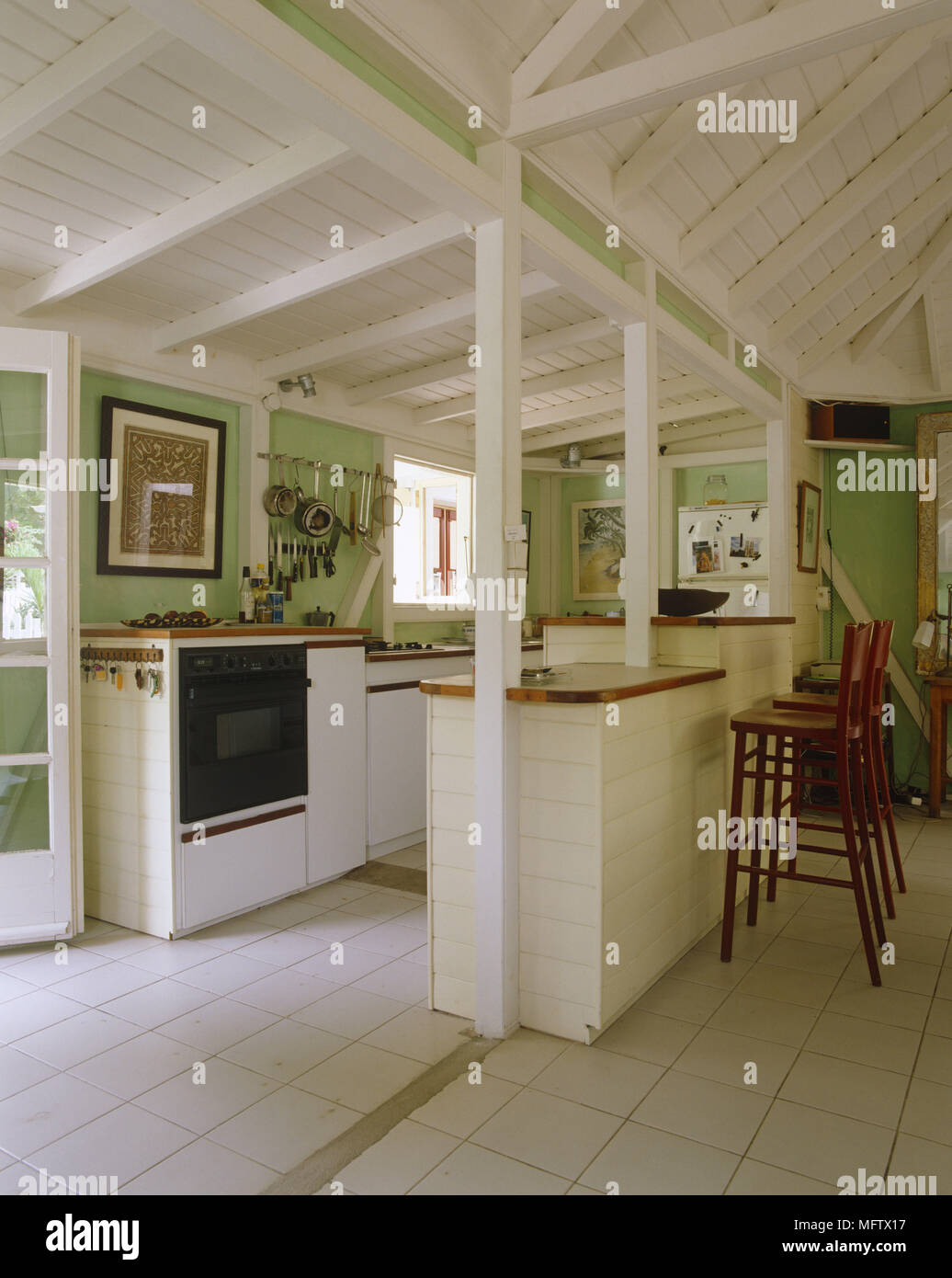 Kitchen With Tiled Floor And Wooden Ceiling Breakfast Bar High Chairs And  Green Walls