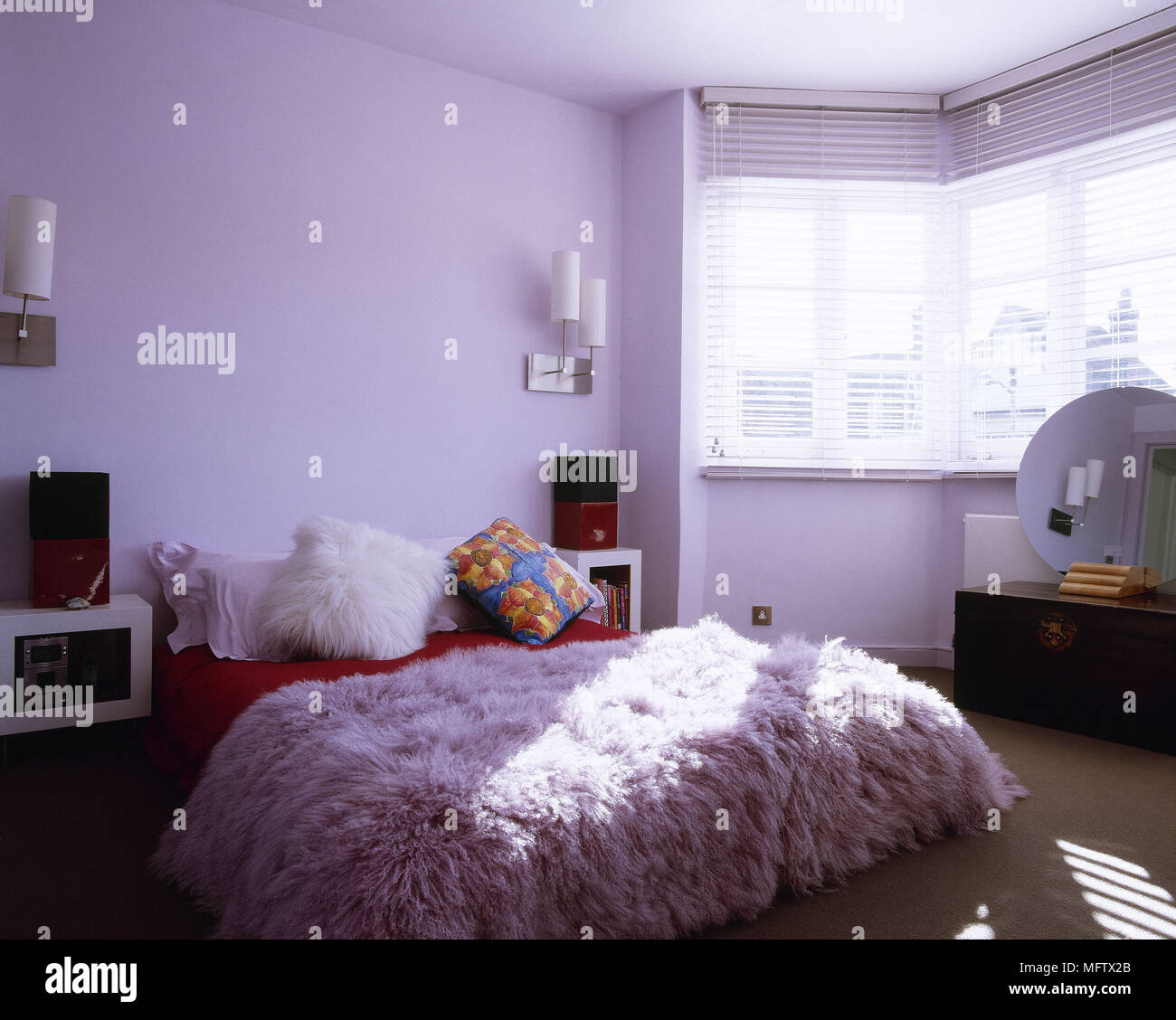 Lavender bedroom with double bed and textured pink bed cover ...