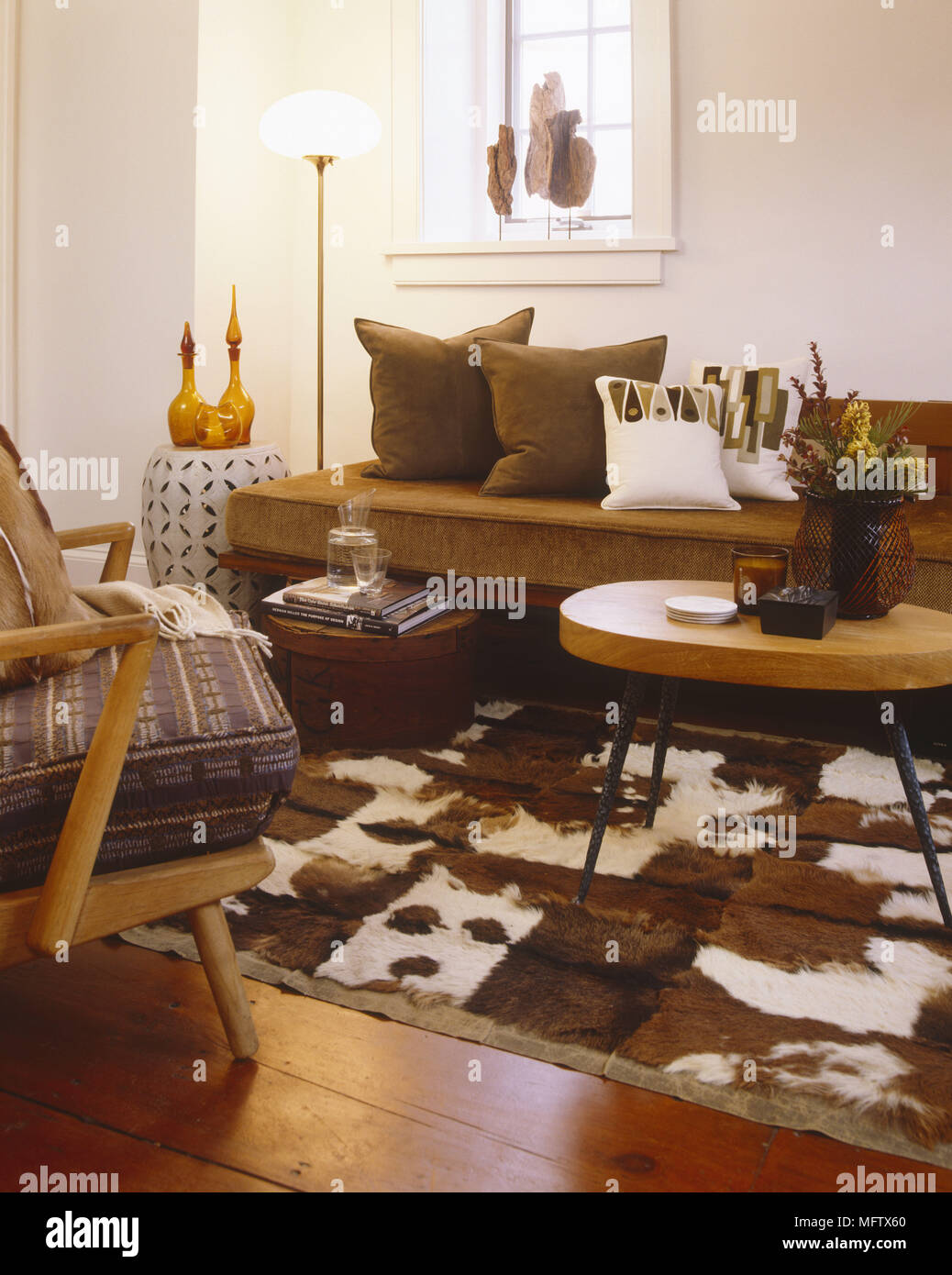 Retro Sitting Room With Cow Skin Rug Bare Stone Walls And Retro Furniture