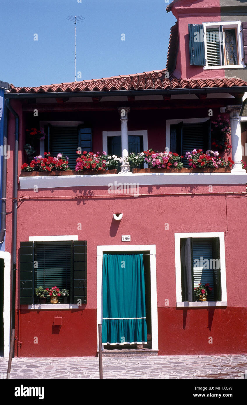 An exterior of a Mediterranean house painted red walls, close up ...