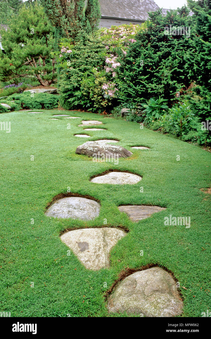 Garden With Stepping Stone Path Embedded In A Lawn Stock Photo - Alamy