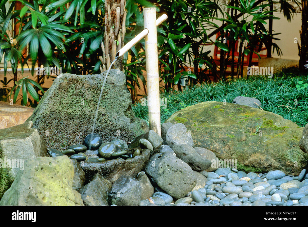 Japans Water Ornament.A Bamboo Water Feature In Japanese Style Garden Stock Photo