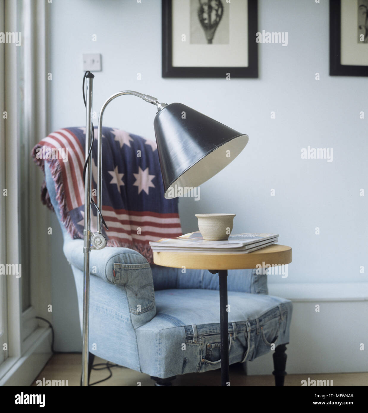 Bon A Detail Of A Modern Sitting Room An Shabby Chic Armchair Upholstered In  Denim Fabric Floor Lamp Side Table Stars And Stripes Throw