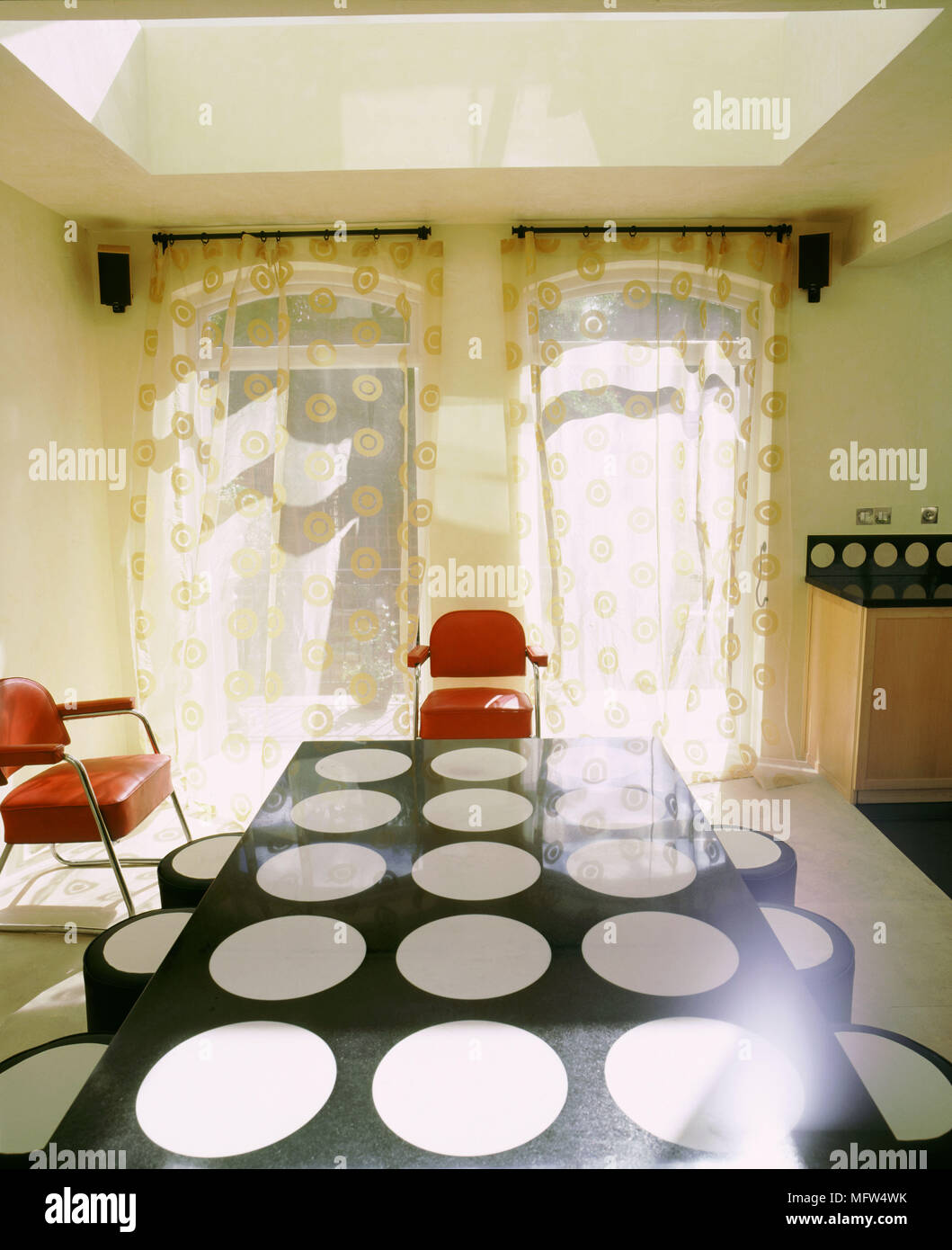 Modern Dining Room Sheer Curtains Black Table With White Circle Design Red Chairs Stock Photo Alamy