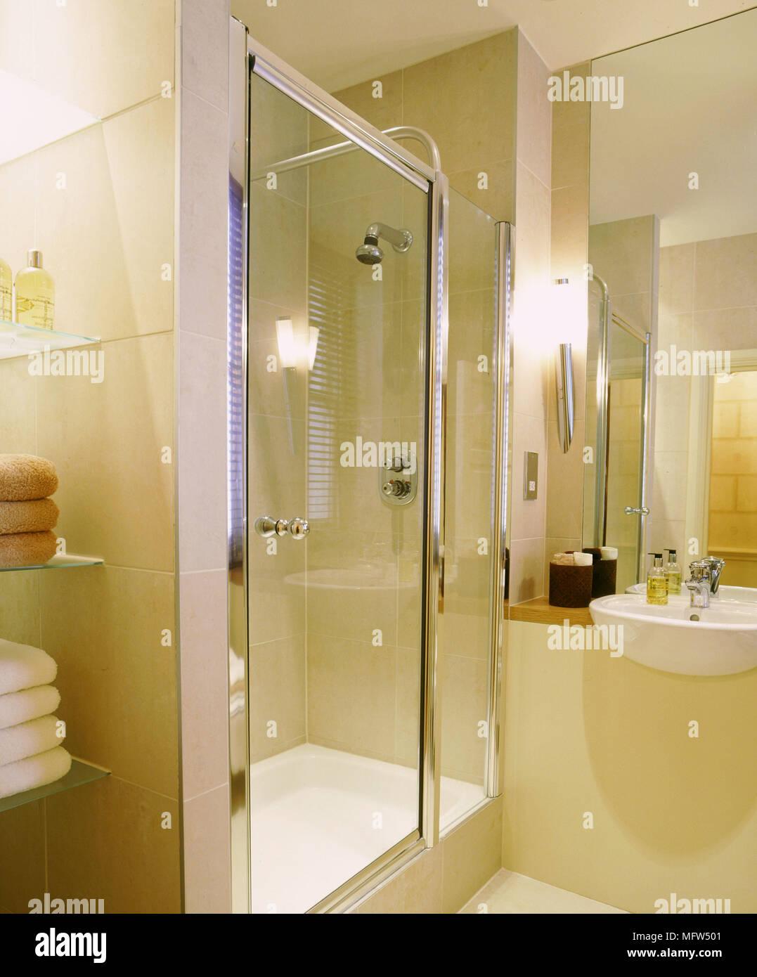 Modern neutral bathroom detail shower cubicle glass door washbasin ...