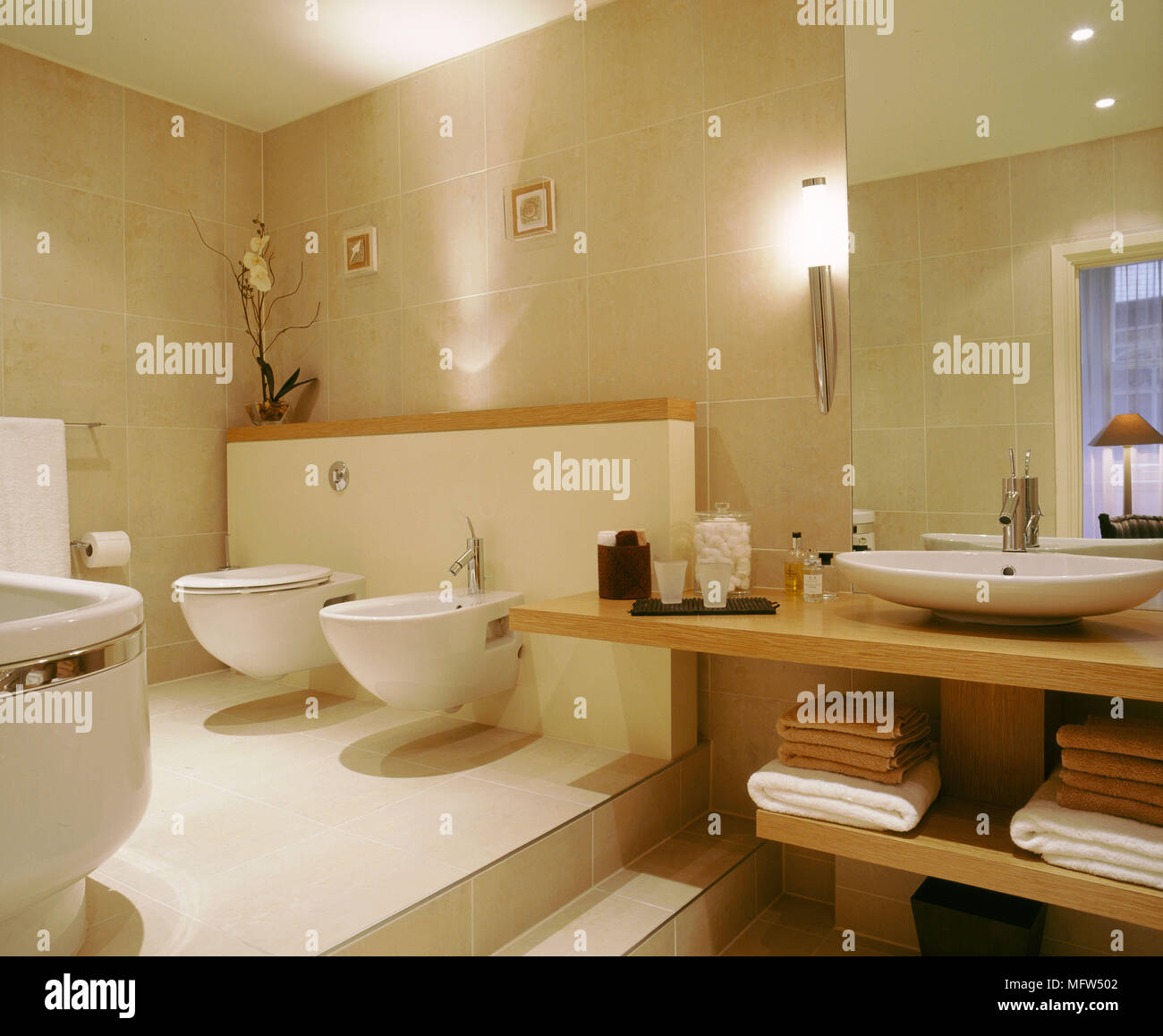 Modern Neutral Bathroom Toilet Bidet Washbasin On Wood Unit Concealed  Lighting
