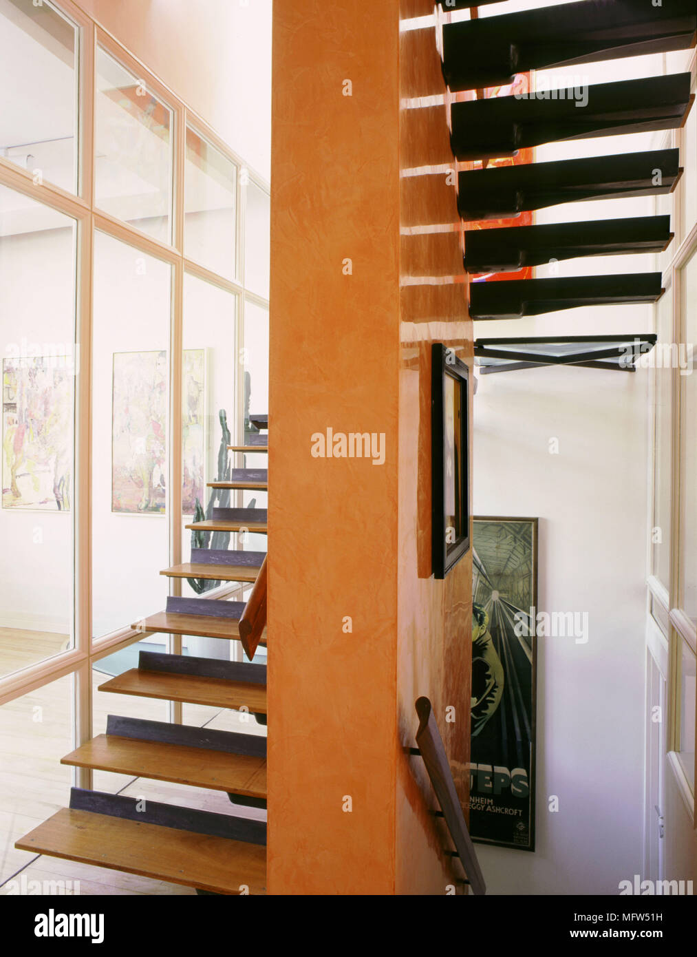 Modern Open Plan Staircase Suspended Wooden Treads Orange Walls Glass Panels Stock Photo Alamy