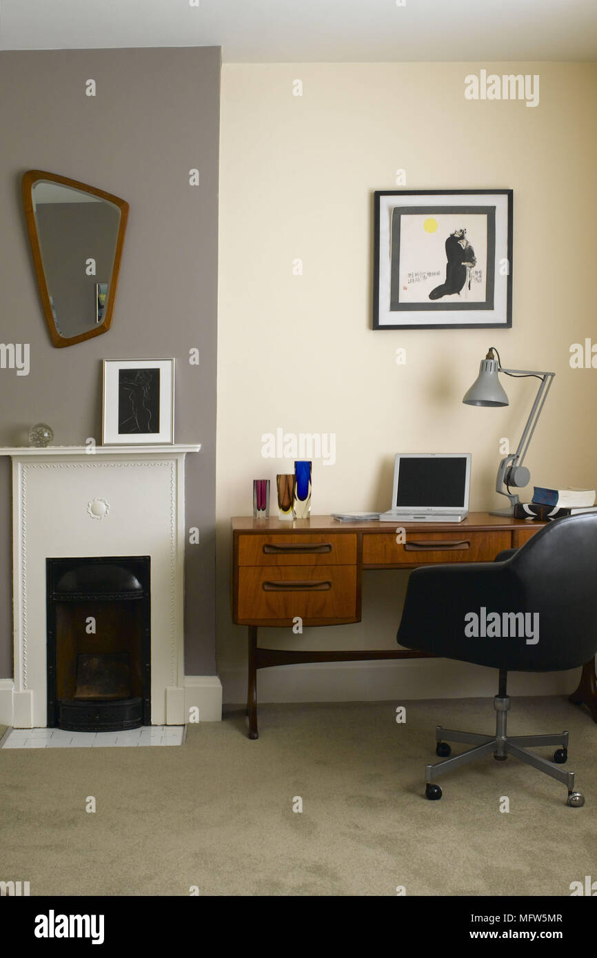 Retro home office Black Modern Home Office With Laptop Computer On Retro Wooden Desk Next To Small Fireplace Alamy Modern Home Office With Laptop Computer On Retro Wooden Desk