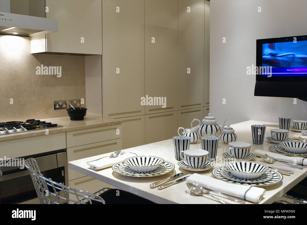 A Modern Kitchen With Beige Kitchen Units Facing A Kitchen Table