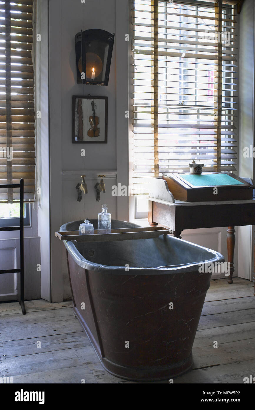 A traditional country style bathroom wooden floorboards an antique ...
