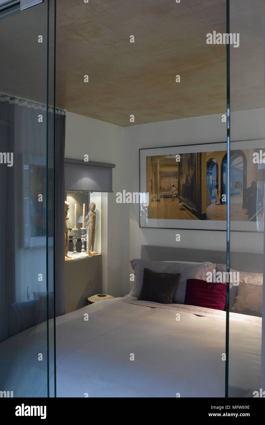 View Through A Glass Doorway Into A Modern Bedroom With Atmospheric