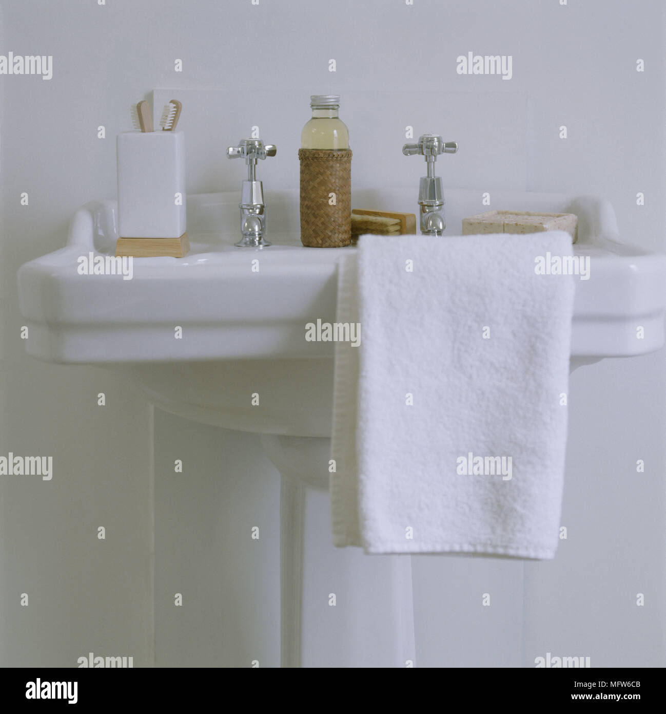 A Detail Of A Traditional Neutral Bathroom Showing A Victorian Style  Pedestal Washbasin Towel   Stock