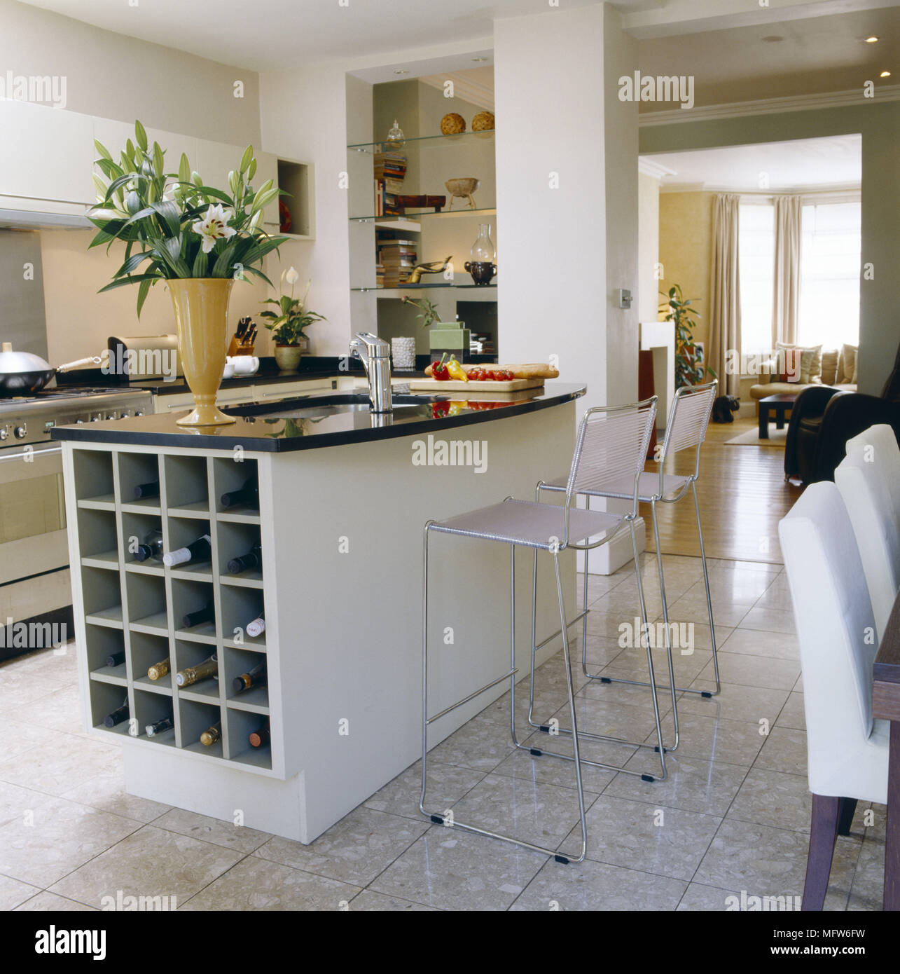 A Modern Kitchen With Dining Area Breakfast Bar Unit Wire Stools
