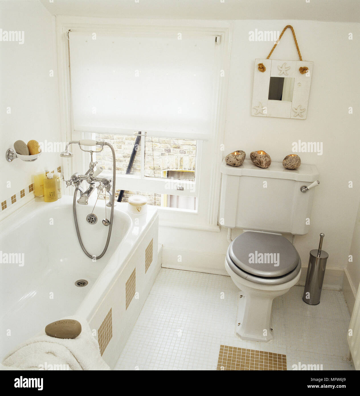 High angle view of a modern bathroom with mosaic tile floor toilet ...