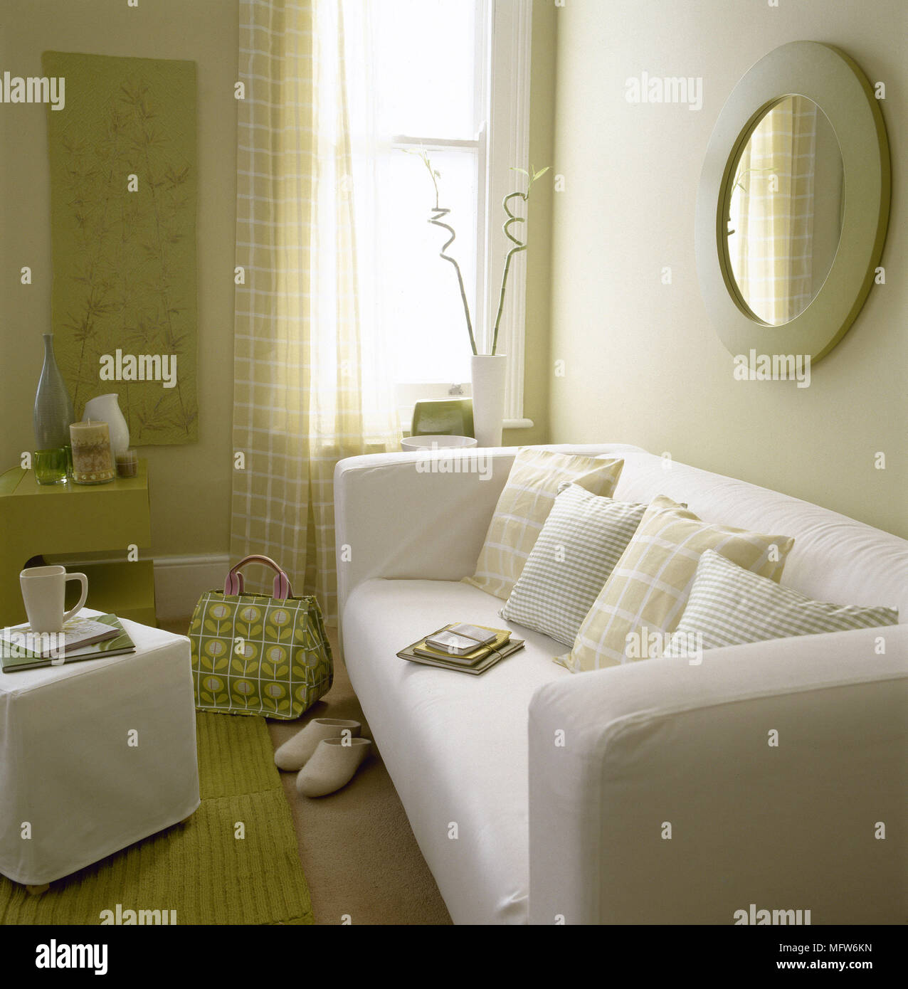 Modern Sitting Room With Upholstered Sofa Sheer Curtains