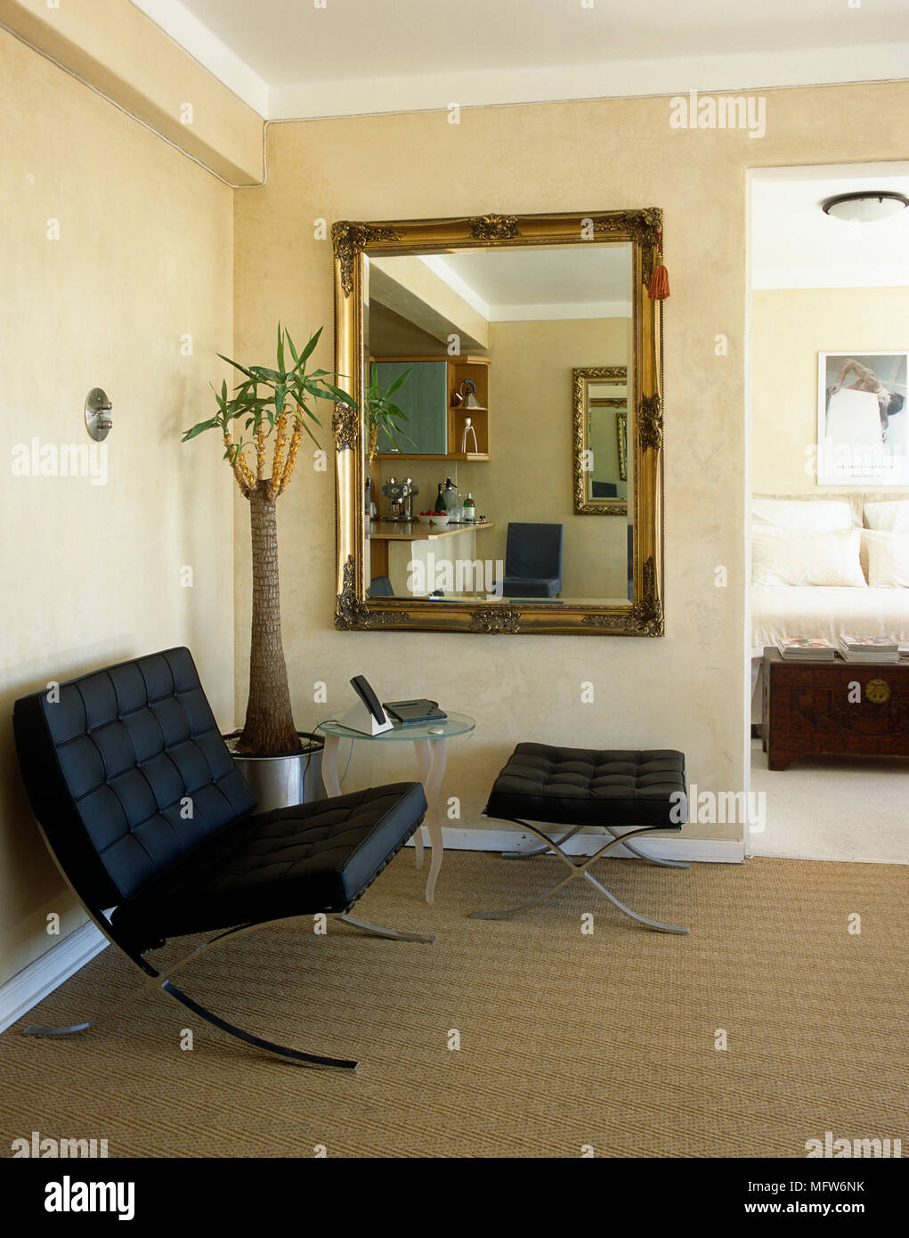 Mies van der Rohe black leather Barcelona chair and ottoman beneath mirror - Stock Image & Barcelona Chair Stock Photos u0026 Barcelona Chair Stock Images - Alamy