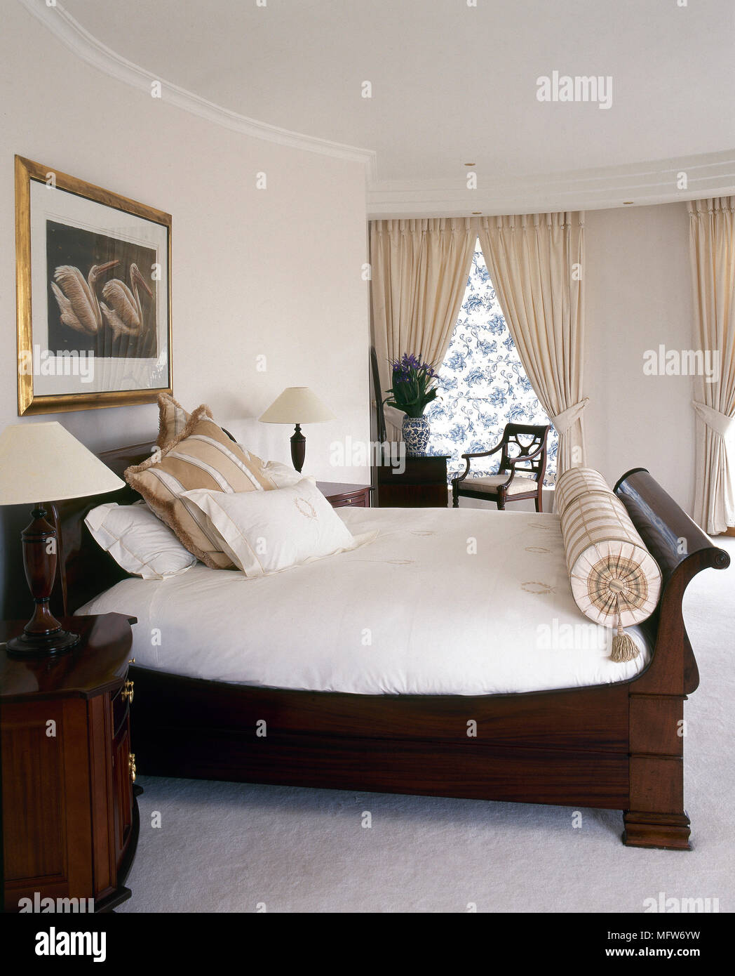 - Traditional, Neutral Bedroom With A Wood Sleigh Bed, White Bedding