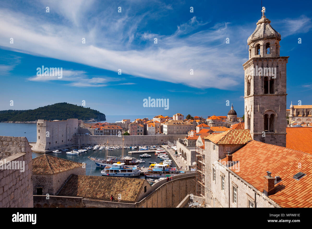 Church tower of Dominikanski Samostan (Dominican Monastery) and the orange-tiled roofs of old town Dubrovnik, Croatia - Stock Image