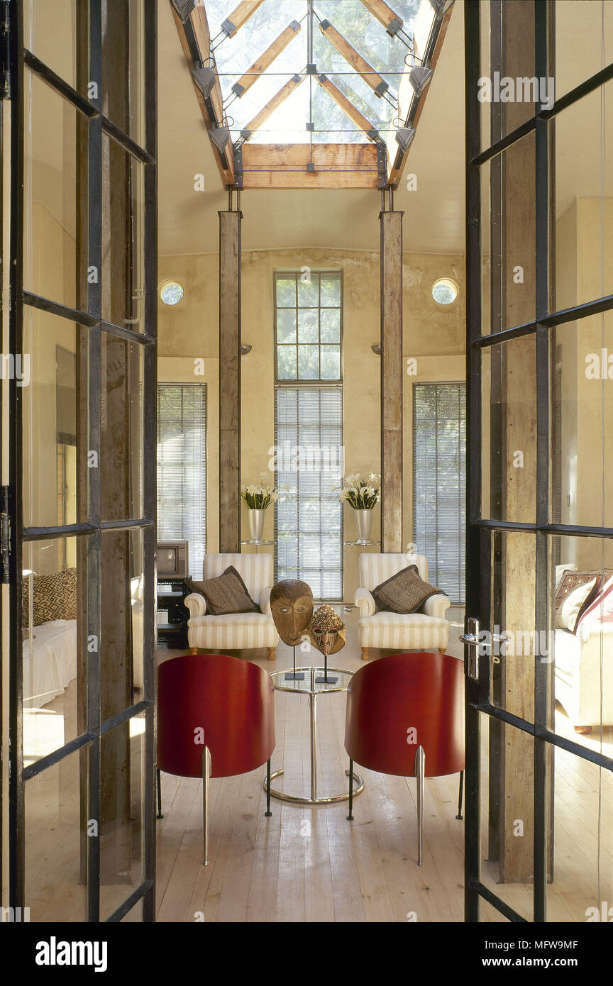 View Through French Doors To Modern Sitting Room Atrium Skylight Interiors  Rooms Architectural
