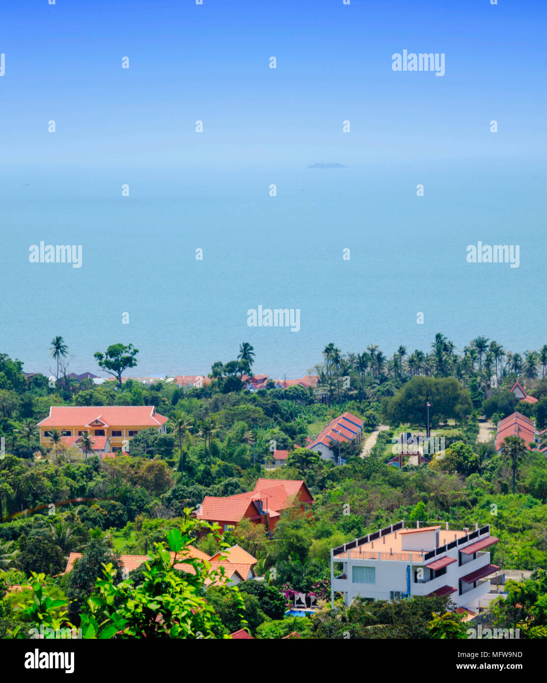 View over the village of Kep in Kampot province, Cambodia from Kep National Park, showing the South China sea and hotel buildings - Stock Image