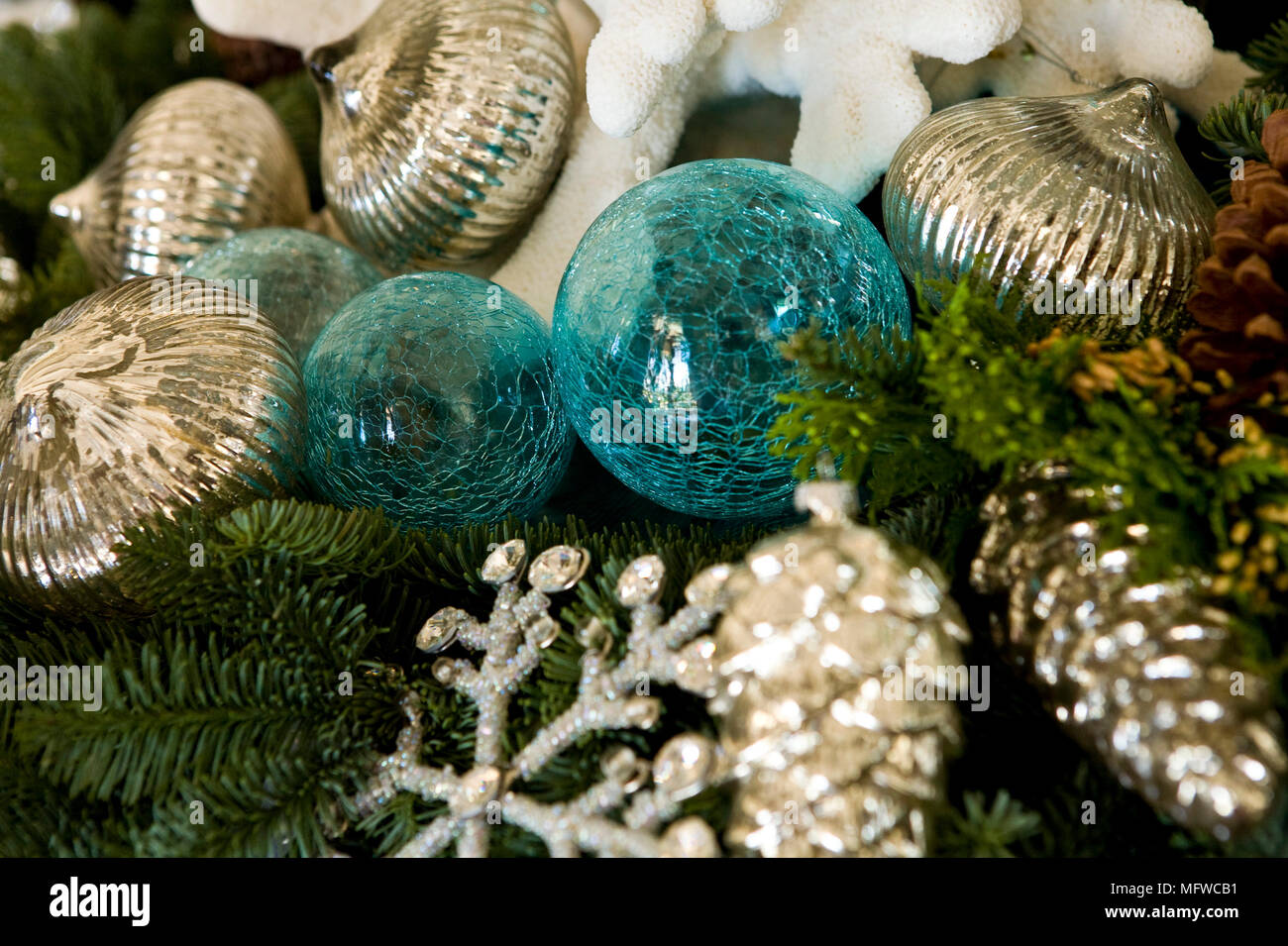 Blue and silver christmas decorations on tree stock photo: 181882037