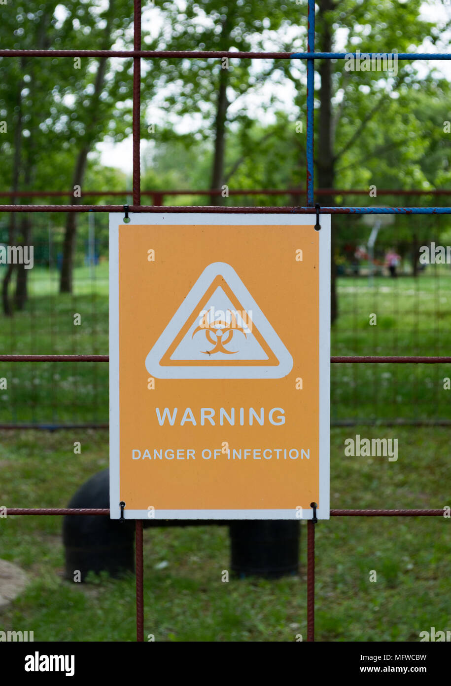 Biohazard sign with text: Warning! Danger of infection. Warning radiation hazard. Warning sign. Stock Photo
